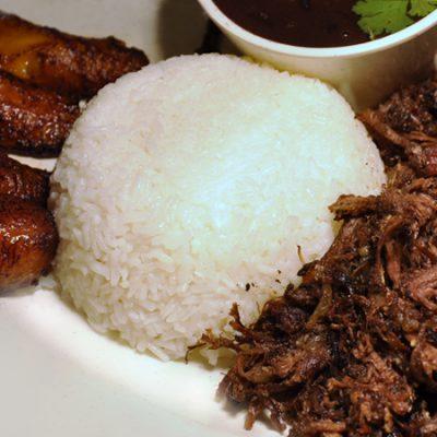 el-rey-de-la-paella-churrasco-steak-serve-with-white-rice-black-beans-and-plantains