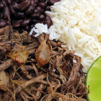 el-rey-de-la-paella-vaca-frita-served-with-rice-black-beans-plantains